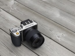 Photo of Hasselblad Camera on wooden deck