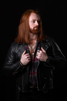 Actor headshot, red hair, ginger male, holding leather jacket
