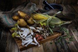 Food Photography, choping board with mushrooms and other root vegetables