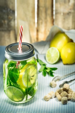 Food photography of mint drink with lemons and limes